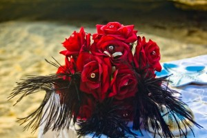RED ROSES, BLUE WATER AT THIS GRAND CAYMAN BEACH WEDDING