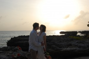 Sunset kiss for newly-weds at My Secret Cove