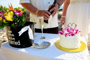Grand Cayman beach wedding with cake and champagne