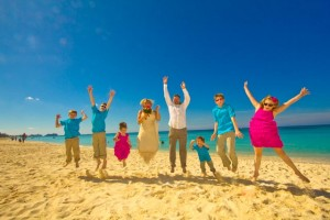 Wedding jump with kids at Governor's Beach